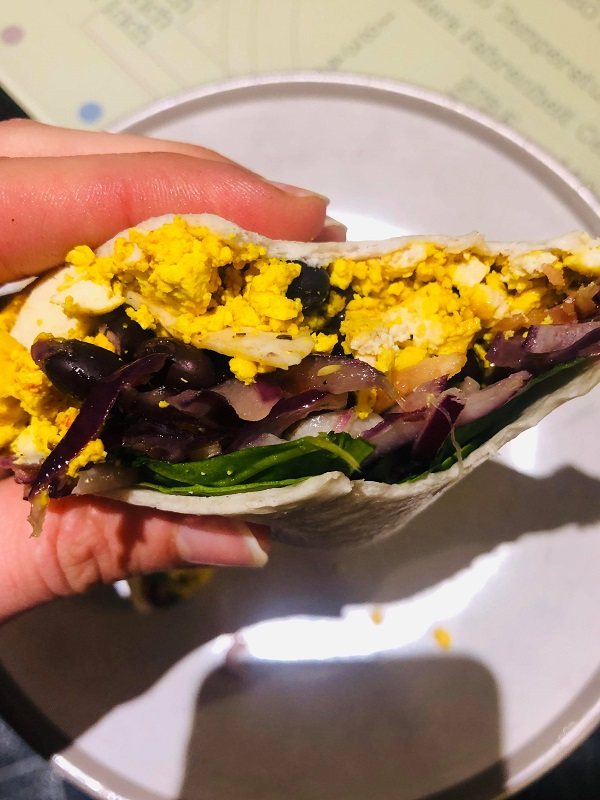 You can build up this burrito however you like. Add or remove a component to preference. I build it up with a simple tofu scramble, some breakfast potatoes or roasted veggies, chickpea pancake that adds more protein, some pepitas, fresh crunchy veggies and a dressing. Its a scramble, veggie, omelet, crunch and dressing burrito. You can also serve these ingredients in a breakfast taco format! Lets make a bunch of these burritos.